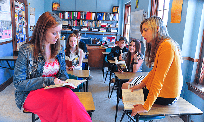 students discussing book